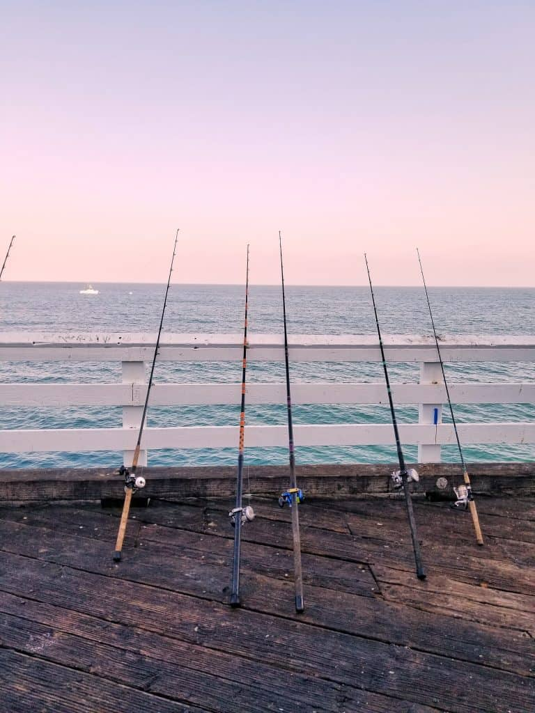 fishing poles on a pier