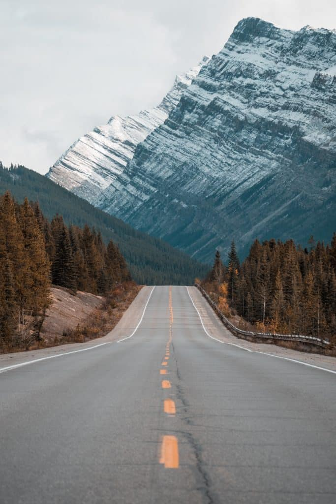 road leading into snowy mountains