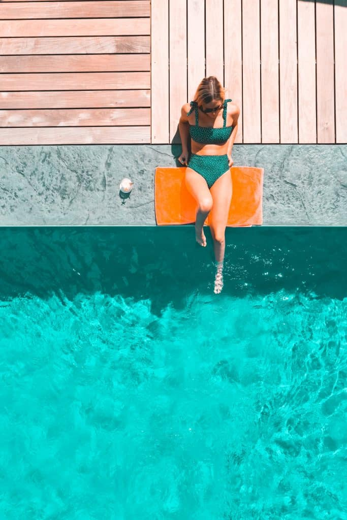 woman relaxing by a pool