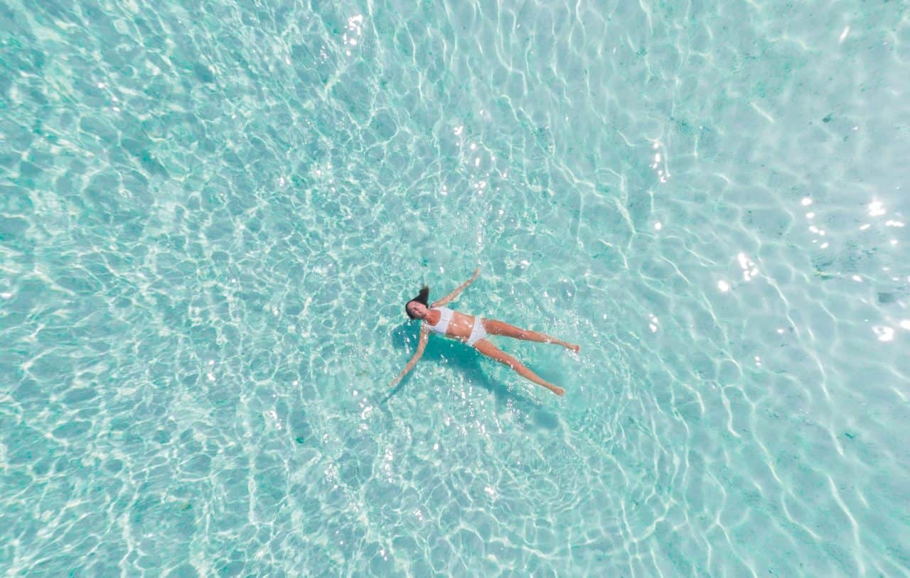 woman floating in a swimming pool