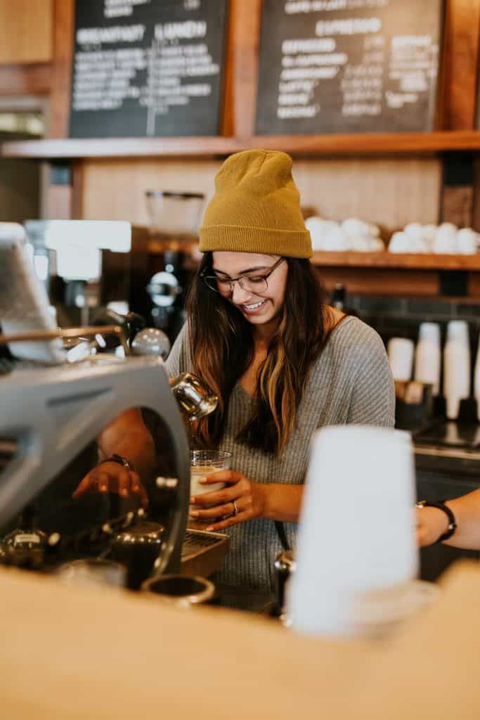 positive and happy girl in coffee shop