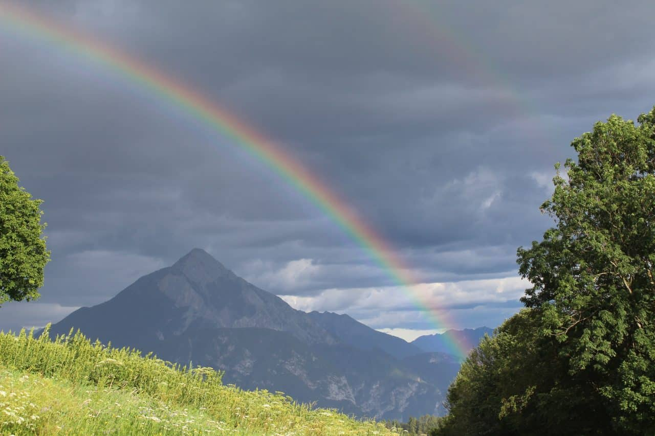 rainbow in the mountains of italy