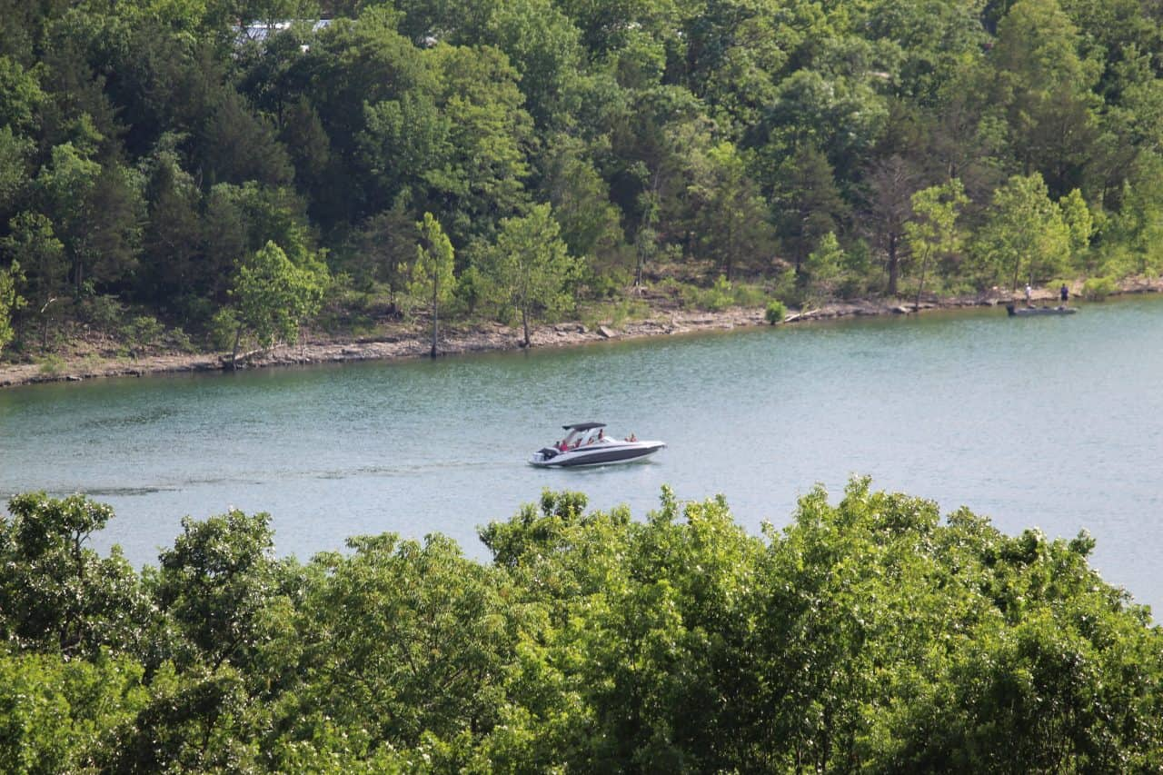 A ski boat driving through the water on Table Rock Lake.