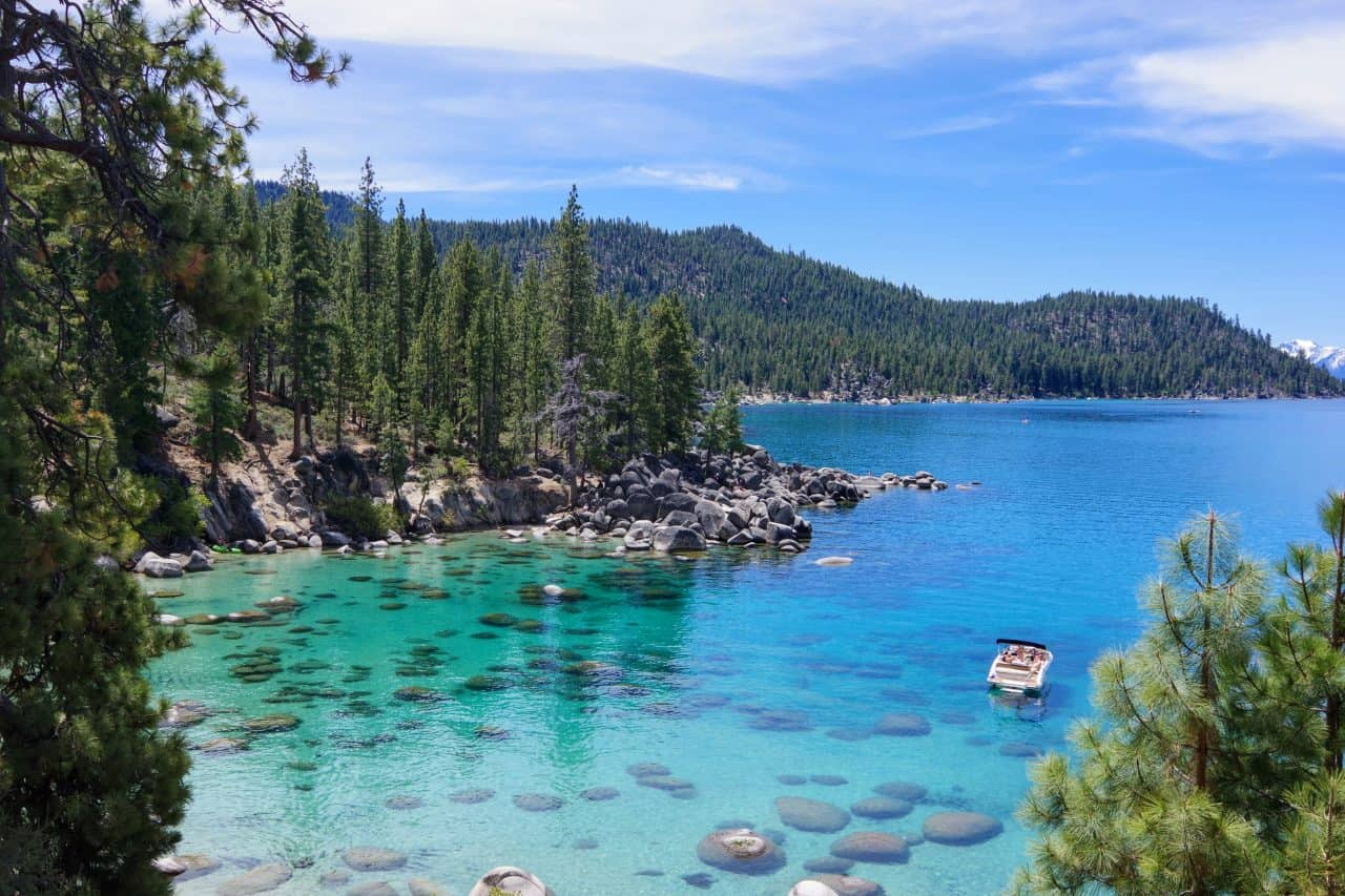 A ski boat floating on the clear blue waters of Lake Tahoe.