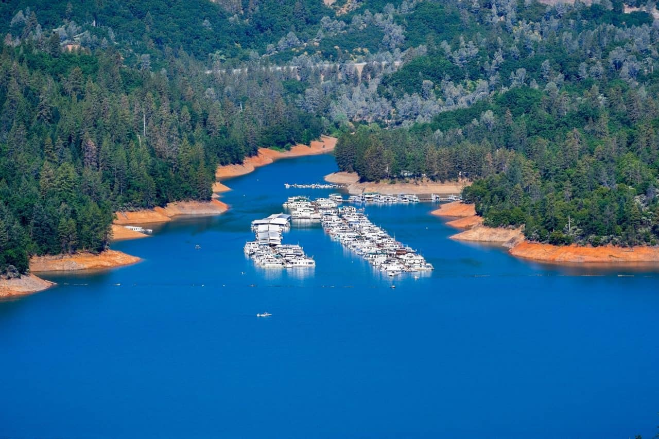 View from the air of ski boats parked at a marina on Lake Shasta.