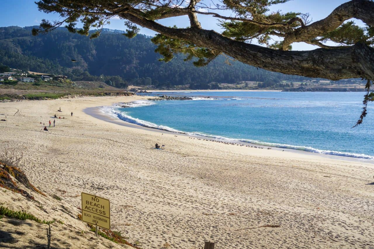 Sand and blue ocean water at Carmel River State Beach.