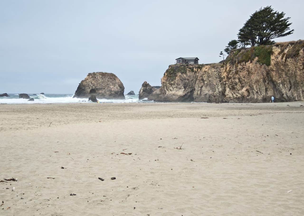 A house on a large rock at Seaside Creek Beach in Northern California.
