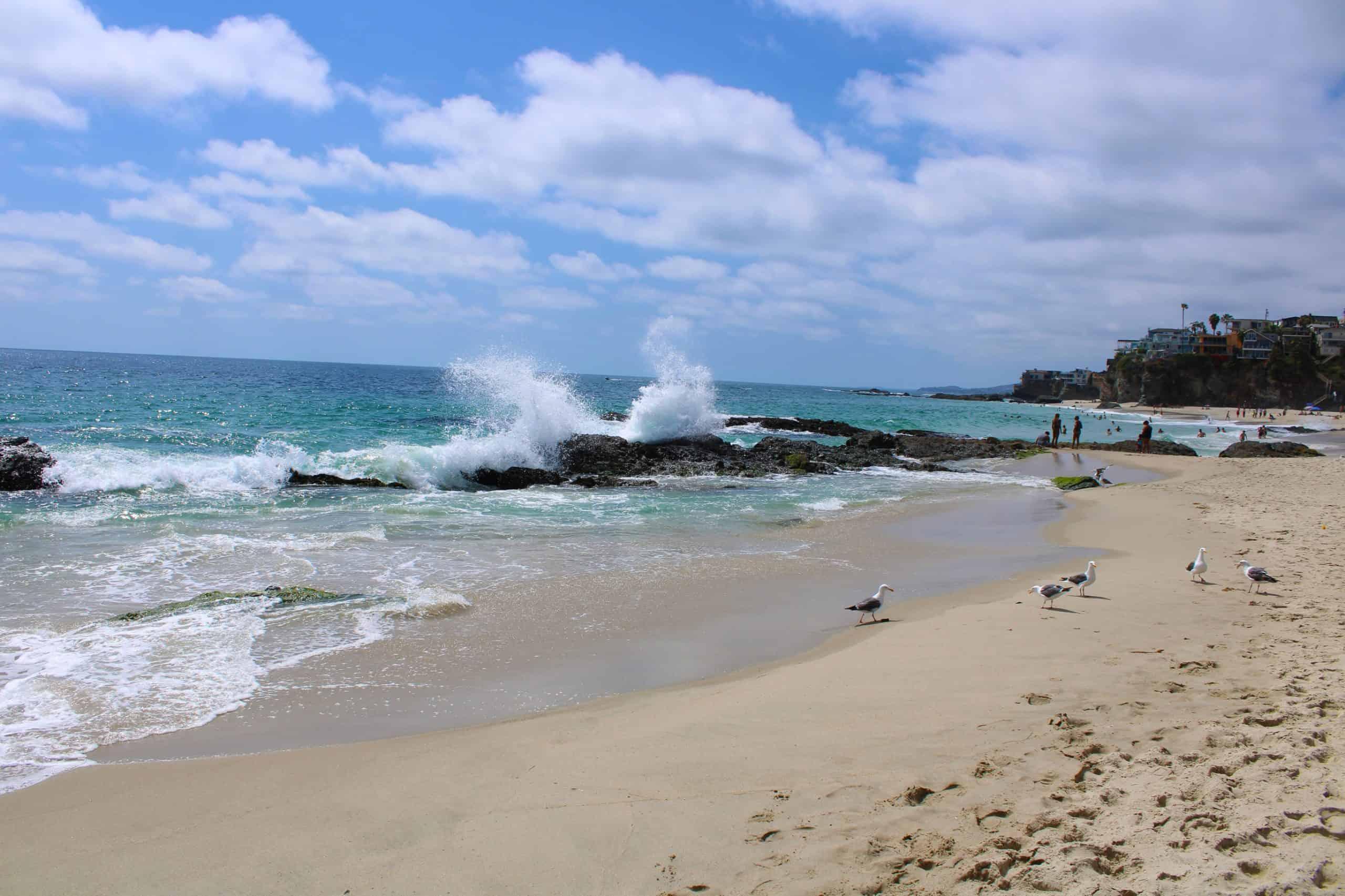 People enjoying 1000 Steps Beach in Southern California.