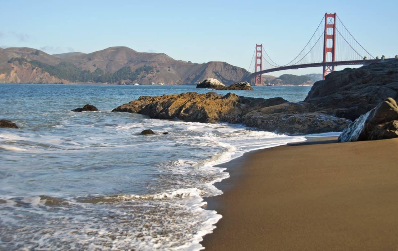 Baker beach with Golden Gate Bride in background.