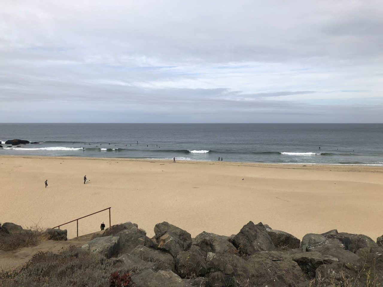 Sand and surfers at Montara State Beach.