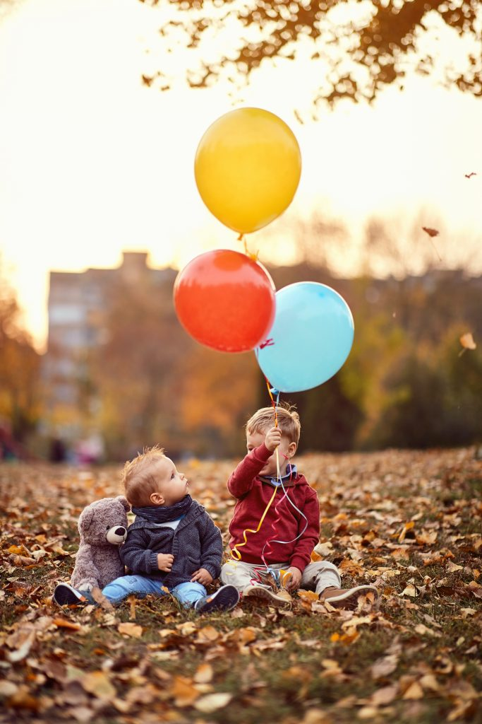 little boys with balloons