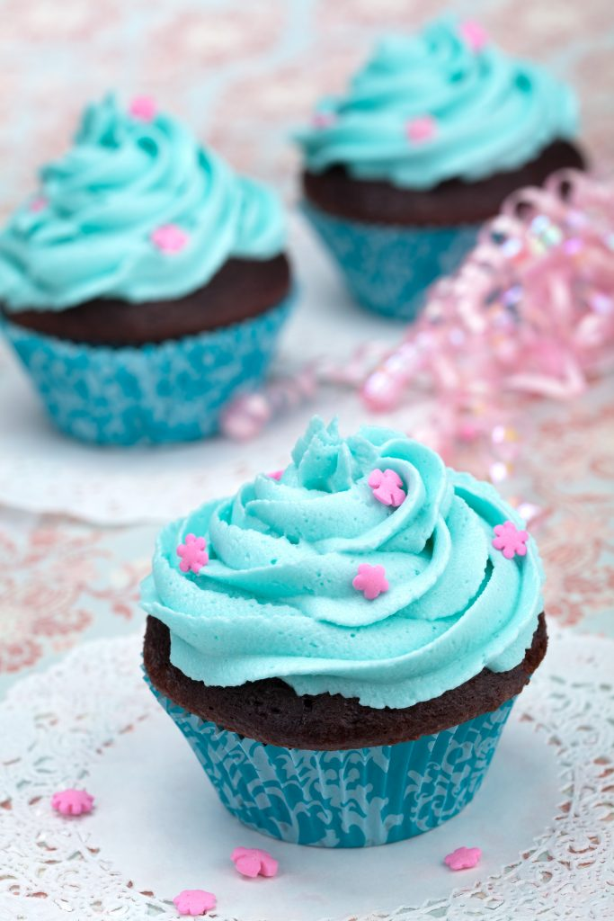 chocolate cupcakes with blue frosting