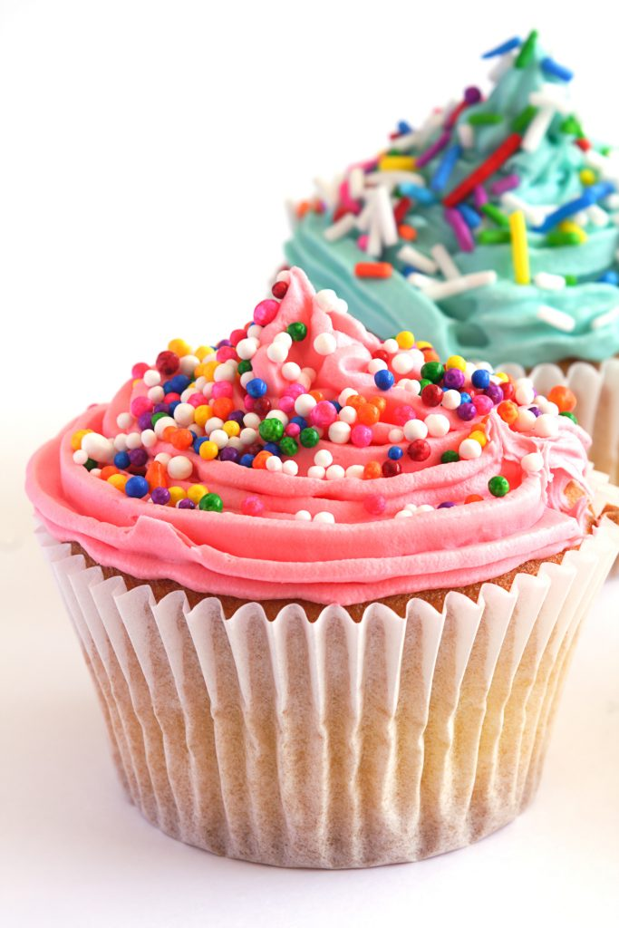 close up of cupcakes with sprinkles