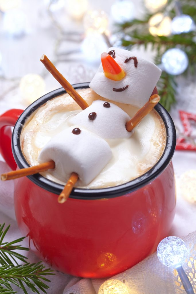 snowman made of marshmallows in hot cocoa