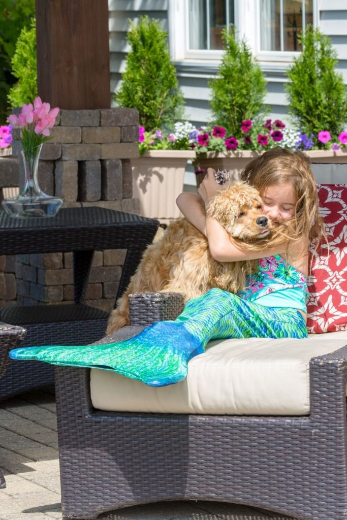 girl with fin and dog