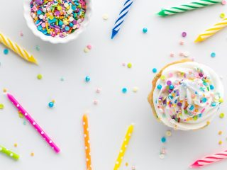 sprinkles, candles and a cupcake