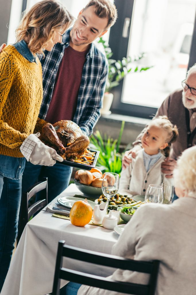 family with turkey at table